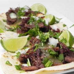 Slow Cooker Lengua (Beef Tongue)  Recipe - Slow cooker lengua, also known as beef tongue, is a surprisingly tender meat. Serve in tacos with onion, tomato, cilantro, and lime wedges.