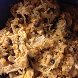 Slow Cooker Mexican Chicken and Rice Recipe - Just combine chicken breasts with rice, salsa, and a few other ingredients, and your slow-cooked dinner almost makes itself.