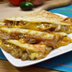 Caramelized Onion and Jalapeno Quesadillas Recipe - Caramelized onion and jalapeno quesadillas are a quick and easy appetizer or meal for vegetarians and non-vegetarians alike.