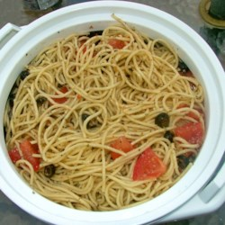 Spaghetti Salad I Recipe - The spaghetti, chopped tomatoes, green onions, cucumbers, and black olives spend the night in the fridge chilling and soaking up all the delicious zesty Italian dressing. Makes eight generous servings.