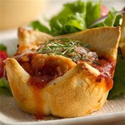 Parmesan Chicken Mini Pies Recipe - Italian-flavored mini pies made easy with frozen chicken bites.