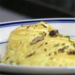 Decadent Omelette Recipe - The unique flavor of truffle oil and shaved truffles transforms this Parmesan cheese omelette.
