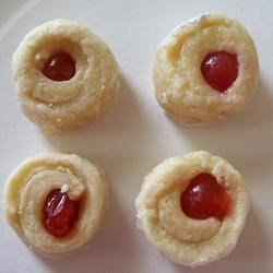 Bon Bon Christmas Cookies Recipe - Cute 'Cherries in a Blanket'  cookies. This recipe goes back at least three generations. My grandma made them, my mom made them, now I make them!