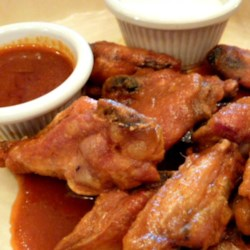 Home-Style Buffalo Wings Recipe - You can get crispy chicken wings without frying by steaming and baking them, as done in this recipe with a homemade Buffalo-style wing sauce.