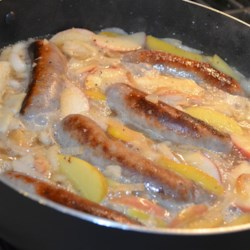 Brats, Onions, and Apples Recipe - Cooking bratwurst in beer is a long-standing tradition. This recipe for the classic preparation also includes apples and onions.