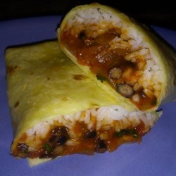 Black Bean and Rice Burritos Recipe - Tasty burritos are filled with black beans and rice and can be garnished with your favorite toppings, including Cheddar and Monterey Jack cheeses, lettuce, and sour cream. They're easy on the budget.