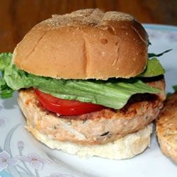 Salmon Rosemary Burgers Recipe - These savory salmon burgers hold up well on the grill, especially if you use a nice fillet of wild king salmon. Serve on an onion roll with lettuce, tomato, mustard, and horseradish for a great barbeque main dish.