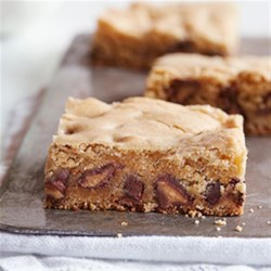 """Blondie"" Bars with Peanut Butter Filled DelightFulls(TM) Recipe - Blondie bars definitely have more fun when they contain a good dose of Peanut Butter Filled DelightFulls."