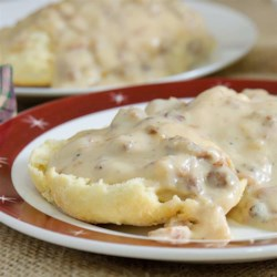 How to Make Country Gravy  Recipe - Comforting, savory country milk gravy thickened with flour and flavored with sausage is just the thing to put on fried chicken, country-fried steak, and biscuits.