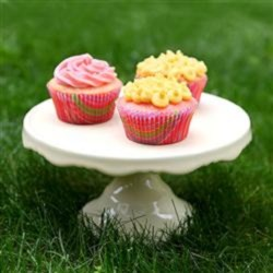 Frosted Pink Lemonade Cupcakes Recipe - Use a box of cake mix and frozen pink lemonade concentrate for an easier version of pink lemonade cupcakes.