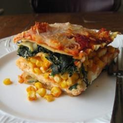 Summer Garden Lasagna Recipe - This no-guilt lasagna is packed with summer-fresh flavors from your garden, mozzarella cheese, and topped with Parmigiano-Reggiano cheese.