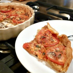 Tangy Tomato Tart (Pie) Recipe - Celebrate garden-ripe tomatoes with a French tomato tart flavored with herbs and Dijon mustard. Serve warm or cold.