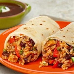 Chicken & Black Bean Burritos Recipe - Sautéed fresh vegetables, garlic and a tasty black bean soup combine with cooked chicken and rice to make the perfect filling for warm flour tortillas. These kickin' burritos are super easy to prepare but the result is a flavor packed meal that can't be beat!