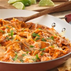 Chicken Chilaquiles from Campbell's Kitchen Recipe - This Mexican-inspired dish features a combination of shredded cooked chicken, tomato chipotle soup, onion, garlic, cheese and crispy tortilla strips. It's easy to prepare, super delicious and guaranteed to be a hit at your dinner table!