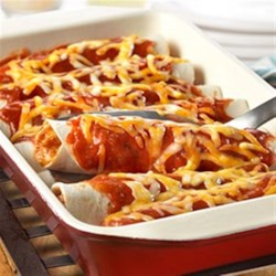 Easy Chicken Enchiladas from Campbell's Kitchen Recipe - Mexican night is made easy with these simple enchiladas that are ready in just 30 minutes. Mexican-style tomato soup, cooked chicken and Colby Jack cheese combine to make a scrumptious filling for warm flour tortillas. Baked until hot and bubbling, these cheesy chicken enchiladas are sure to earn rave reviews.