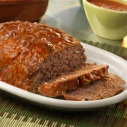 Meatloaf with Tomato Chipotle Sauce Recipe - What makes this meatloaf so good? The addition of tomato chipotle and olive oil soup yields incredibly moist and flavorful meatloaf. This is classic comfort food at its best!