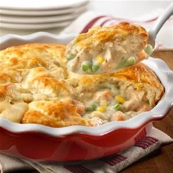 Quick Chicken Pot Pie from Campbell's Kitchen Recipe - You can have a delicious pot pie on the table quickly and easily. A combination of cooked chicken, frozen veggies and creamy herb and garlic soup is topped with biscuit crust and baked to golden perfection. Give it a try, this is comfort food that's sure to become a family favorite!