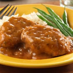 Sweet Onion Pork Medallions Recipe - Sautéed pork medallions simmer in an irresistible sauce made with sweet onion soup, honey and Dijon-style mustard. Serve them with mashed potatoes for a restaurant quality meal that's guaranteed to impress.