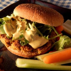 Quinoa Veggie Burgers Recipe - Quinoa veggie burgers topped with a homemade tahini sauce are a quick, vegetarian meal for any day of the week.