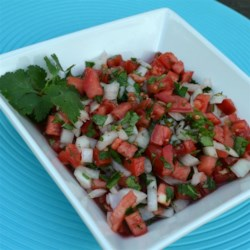 Scott's Pico de Gallo Recipe - Tomatoes, cilantro, onion, and fresh lime juice blend in this quick and easy version of pico de gallo.