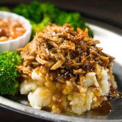 Shredded Pork Recipe - This tender slow cooker pulled pork with apple butter, apple cider vinegar, apples, and Dijon mustard brings the flavors of autumn to the dinner table.