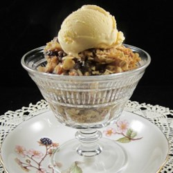 Apple and Dried Cranberry Crisp Recipe - Apple and dried cranberry crisp is a warm and comforting dessert to make for cold fall evenings; top with vanilla ice cream.