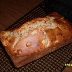 Apple Pie Bread Recipe - A quick bread spiced with cinnamon and cloves and speckled with chunks of apple.