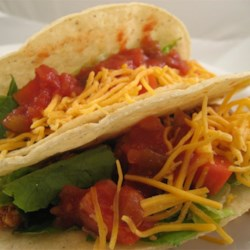 Tofu Tacos I Recipe - Tofu is spiked with chili powder, cumin, cayenne, lime juice and tomato sauce, and cooked with cilantro to make a delicious taco filling.