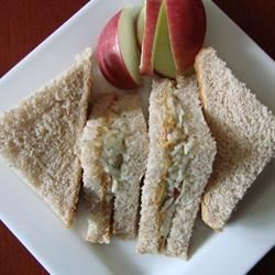 Peanut Butter and Apple Sandwich Recipe - My kids love to spread peanut butter on their apples, so one day I thought I would take a favorite of theirs and just tweak it a little bit....voila, a peanut butter and apple sandwich.  PB and J can get boring after a while and this provides a healthy alternative.