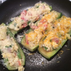 Egg Stuffed Zucchini Recipe - Zucchini stuffed with eggs, walnuts, and tomatoes is a quick and easy meal that will quickly become a family favorite.