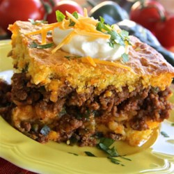 Hot Tamale Pie Recipe - While this tamale pie has very little to do with its south-of-the-border namesake, it's a really delicious recipe all the same.