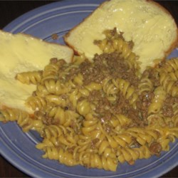 Beefy Cheesy Pasta Recipe - Ground beef flavored with soy sauce, pasta and cheese -- quick and tasty.