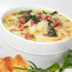 Restaurant-Style Zuppa Toscana Recipe - Crumbled bacon, Italian sausage, chopped kale and cream are combined in this chicken stock based soup with potatoes.