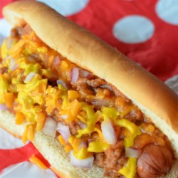 Texas Hotdog Sauce Recipe - When I was small we would always stop and get hot dogs smothered in a flavorful meat sauce on the way to Gram's. Dad worked and experimented, and finally came up with a sauce that tasted just as good. Be sure to spread the hot dog rolls with mustard and top them off with chopped onion.