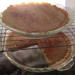Milk Tart Recipe - The sugary crust dough is pressed into the pie tin and baked. The sweet, milky thick custard filling is then poured into the baked shell, sprinkled with cinnamon and chilled. Makes two lovely pies.