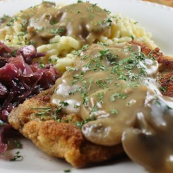 Jaeger Schnitzel Recipe - Cubed pork is breaded and fried, then combined with mushrooms and hunter gravy, and served over a bed of noodles.