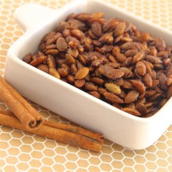 Cinnamon Toast Pumpkin Seeds Recipe - Cinnamon and sugar are baked onto fresh pumpkin seeds for a sweet cinnamon toast-flavored treat during Halloween season.