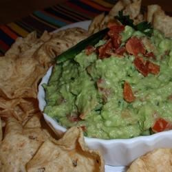 California Guacamole with Bacon Recipe - Crispy, crumbled bacon adds a tasty variation to traditional guacamole. Serve with tortilla or pita chips.