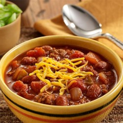 30-Minute Chili Recipe - Chunky chili made quickly with ground meat, beans, and two kinds of tomatoes for lots of flavor--perfect for a weeknight meal.