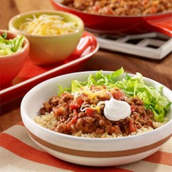 Beef Taco Quinoa Bowl Recipe - A quinoa bowl recipe with taco seasoned beef, tomatoes and cheese topping quinoa.