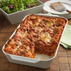 Cheesy Beef Lasagna from Hunt's(R) Recipe - Hearty lasagna recipe with a ground beef meat sauce and three cheeses layered with uncooked lasagna noodles to save some work.