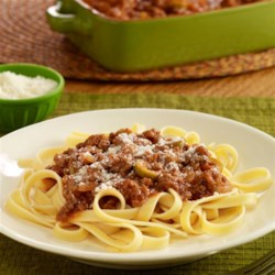 Chorizo Bolognese Recipe - A Latin-inspired Bolognese sauce recipe with ground beef, chorizo, sliced olives, adobo seasoning and tomato sauce served over pasta.