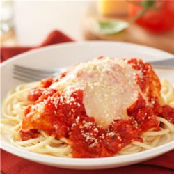 Easy Chicken Parmesan from Hunt's(R) Recipe - This is an easy chicken Parmesan recipe when chicken bakes in Hunt's(R) Tomatoes with Kraft(R) Parmesan and is topped with mozzarella and served over spaghetti.