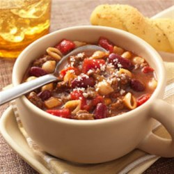 Easy Italian-Style Chili Recipe - A traditional chili recipe takes on an Italian influence when Hunt's Tomatoes join shell pasta and Kraft(R) Parmesan.