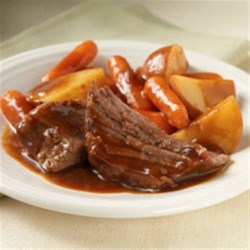 Easy Slow Cooker Pot Roast Recipe - Zesty onion soup mix combined with tomato sauce and prepared gravy makes an easy sauce for this slow-cooked pot roast.