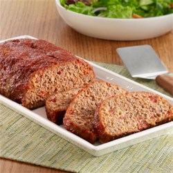 Home-Sweet-Home Meatloaf Recipe - Brown sugar and tomatoes with onions add tangy-sweet flavor to this juicy meatloaf.