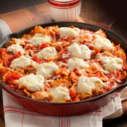 Hunt's(R) 'Classic' Skillet Lasagna Recipe - An easy lasagna recipe made in a skillet with bowtie pasta, Italian sausage, tomatoes and three kinds of cheese.