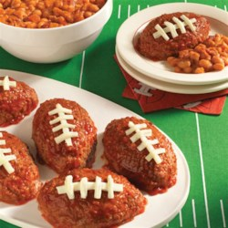 Hunt's(R) Touchdown Mini Meatloaf Recipe - Delicious oval-shaped meatloaves glazed with rich ketchup before baking and finished with string cheese to look like footballs.