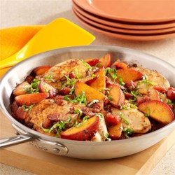 Peach Balsamic Chicken Skillet Recipe - A one-skillet chicken recipe with fresh peaches and diced tomatoes tossed with balsamic vinegar and topped with fresh basil.