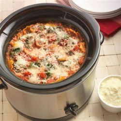 Slow Cooker Mushroom Spinach Lasagna Recipe - A vegetarian lasagna recipe made with a mushroom-spinach-tomato sauce layered with uncooked lasagna noodles and cheese in a slow cooker.